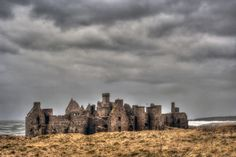 Slaines Castle by Peterhead, Scotland Slains Castle, also known as New Slains Castle to distinguish it from nearby Old Slains Castle, is a ruined castle in Aberdeenshire, Scotland. It overlooks the North Sea from its cliff-top site . At one time it had t Scotland Castles, Scottish Castles, Top Site, To Infinity And Beyond, Medieval Castle, Haunted Places, Scottish Highlands, Scotland Travel, Wonders Of The World