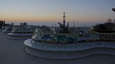 Benches at Parc Guell in Barcelona Spain at sunrise.
