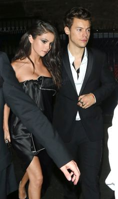 "lianourielle:  "" The Styles couple was seen entering a release party for Harry's new magazine cover. The amount of famous people we saw entering the party was insane but we have to say the hottest couple we spotted were these two. Dressed in black and..."