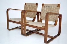 Pair of armchairs with wooden frame and seat in rope, des. Giuseppe Pagano 1941
