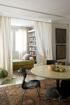 "Book nook - Such a cool use of the ""sunroom"" common in Chicago-style apartments. Line a wall with bookshelves to the ceiling, put in a chaise, and put white curtains across the open doorway."