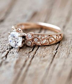 Pink Gold Victorian Halo Engagement Ring. Found on www.bridebug.com