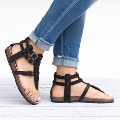 This chic criss cross sandal is sure to become a go-to favorite! Size: We recommend that you order 1/2 size up since this style have been running a bit small Features: Slip-on design for easy on and off Faux leather strap construction Size adjustable buckle Faux cork midsole with a soft, molded foot bed to comfortably cradle your foot Colors: Black Brown Taupe