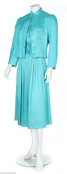 A turquoise Catherine Walker dress proved a surprise hit, with the winning bidder paying £5,250 for the frock which was only expected to reach a top price of £1,000