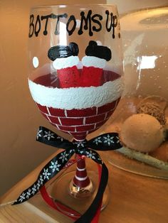 Bottoms up Santa 20 oz wine glass. Heat set although recommend hand wash.