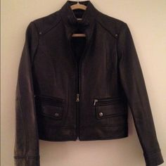 NEW Kenneth Cole Reaction Leather Jacket This jacket is 100% leather and has never been worn! It is in great condition and offers multiple pockets with dark copper features and a structured body. Perfect for day or night. Only flaw is small scratch on back of jacket, see photo as it is barely noticeable Kenneth Cole Reaction Jackets & Coats