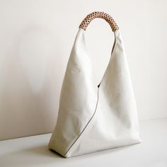 Woven Triangle Bag in color Ivory Triangle Bag, Origami Bag, Sacs Design, Minimalist Bag, Fabric Bags, Fabric Basket, Branded Bags, Leather Handle, Purses And Bags