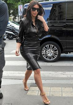 Out and about: She teamed her latest garment with a pair of gold heels and wore her tradem...
