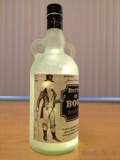 """This post is about a """"Bottle of Boos"""" I created for Halloween. This post covers how to drill the hole, frost the glass, and install the lights. Potion Bottle, Vodka Bottle, Bottle Lights, Halloween Crafts, Bottles, About Me Blog, Glass, Diy, Drinkware"""