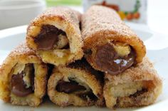 Nutella French Toast Rolls with Cinnamon Sugar- tried different combinations. Nutella and bananas and Nutella and marshmallow fluff were the winners. Easy enough for the kids to help French Toast Rolls, Nutella French Toast, What's For Breakfast, Breakfast Recipes, Dessert Recipes, Fruit Dessert, Desserts, Yummy Treats, Yummy Food