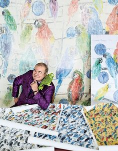 In Fine Feather | Hunt Slonem with his parrot Perky and samples from his new line of fabrics, wallpapers, and rugs for Lee Jofa's Groundworks brand.