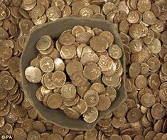 The collection of 824 gold staters was found in a broken pottery jar buried in a field