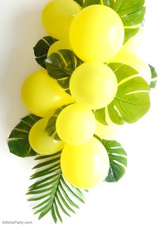 DIY Balloon and Fronds Tropical Party Table Centerpiece Garland - learn to make this easy table decor for your birthday table, party photo booths or summer party decorations!                                                                                                                                                      More