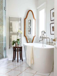 Traditional styling meets modern functionality in this small bathroom. Crisp whites mingle with darkly stained wood to create contrast and make the room feel more open. The clean-lined, freestanding tub creates a striking style statement along one wall. http://www.bhg.com/bathroom/small/small-bathroom-ideas-traditional-style-bathrooms/?socsrc=bhgpin010415traditionaltrendybathroom&page=8