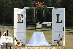 Vintage doors made for alter at outdoor wedding | Ce Ce DesignsCe Ce Designs
