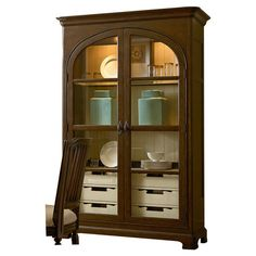 Featuring 2 glass doors and a tobacco finish, this versatile wood cupboard adds farmhouse-inspired style to your decor. 3 lighted shelves showcase your heirl...