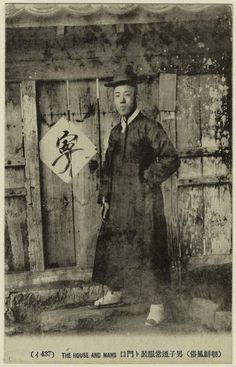 "437 ""The house and mans"" [Korean man in everyday clothing.] Postcard"