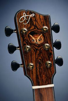OWL GUITAR - Judy Threet's inlaid headstock of an owl peaking out of the knot hole home in this dark walnut colored wood of a six string guitar. - cSw - http://www.pinterest.com/claxtonw/4-5-6-strings/ -  Dark tuning pegs. Nice photo pin via messicka.