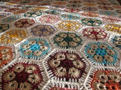 African Flower crochet blanket, aka Paperweight.