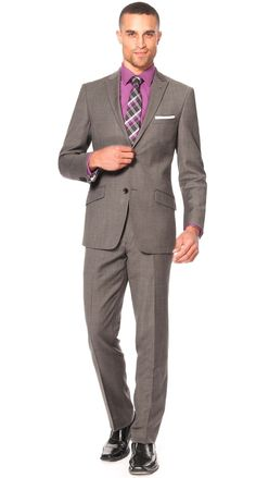 Sleek, effortless dressing made simple. This versatile grey pinstripe suit is styled in a 2 button double vented jacket with slant flap pockets. Additionally the peak lapelprovides the outstanding ability to define the perfect formal look which most businessmen seek for. $498.00
