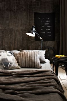 Imagining this as my next bedroom until I find a decent bed frame: dark walls, bed on floor, lamp lighting from behind.
