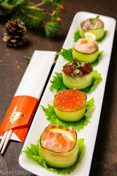 27 Delicious Spring Wedding Appetizer Ideas: cucumber wrapped sushi topped with salmon roe, yellowtail, tuna, and sweet shrimp #springwedding; #appetizer