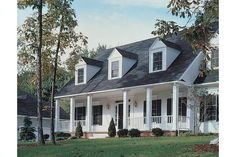 white vinyl, black shutters and black roof. This home is identical to ours. This photo is the deciding factor for going black on the new roof. LOVE, LOVE