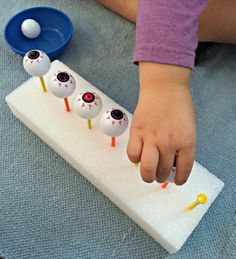 fun fun fun.. balance pingpong balls on golf tees, then try to squirt them off with a water gun... fine motor skills, check!