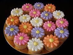 Spring Flower Cupcakes - Simple little cc's. Tip 127 petals and tip 12 centers.