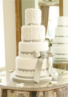 Lace appliqued cake inspired by brides dress