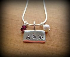 Texas Aggies  sterling stamped necklace. She does custom designs I think that this would be a cute UW necklace or ADPI! by kjanew