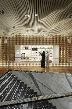 "Following the project in Aoyama, Tokyo, this is the brand's second flagship space that opened in Dubai. Upon entering the space, one will have a view over two floors at once, consisting of a dining floor and a floor called ""the garage,"" which also functions as a gallery space. These spaces are furnished with the brand's characteristic elements such as the spindle grille and a collection of automobile parts embedded underneath the glass floors. While adhering to the concept of its Tokyo space…"