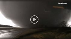 Being dangerously too close to a tornado!!!!  This might be the calmest reaction to a tornado ever caught on camera.