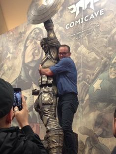 He clung to it for his dear life. Also, he nearly ripped his pants jumping on the statue from the stage