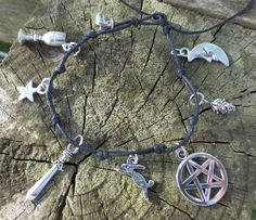 Hedge Witch Silver 8 Charm Bracelet - Simple Tie Pagan Wiccan Knotted Charm Bracelet by PhoebesBazaar on Etsy