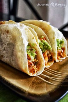 Crockpot Chicken tacos...I've made these twice with cream cheese and without...the boys love them both ways!!