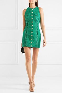 BALMAIN Lace-up suede mini dress $5,105 Balmain's mini dress is cut from buttery suede in a rich jade hue. This form-fitting style is defined by the label's signature embossed gold buttons and flattering lace-up panels. The satin lining ensures the smoothest fit.   Shown here with: Prada Shoulder bag, Gianvito Rossi Sandals, Marni Ring.