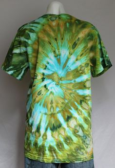 Turn heads while wearing this gorgeous shirt that is dyed in a spiral pattern with turquoise, chartreuse, amber and other shades of green which look even more amazing in person.  Shirt- 100% cotton Bella Canvas - V neck Size- UNISEX Medium MED Condition - New  All of my tie dyes are one of a kind No two are ever alike and pre-washed.  Measurements- chest/bust: 35 inches length: 26.25 inches  **Wash in COLD water with darks or separately **Hang to dry  ❤️❤️❤️❤️❤️❤️❤️❤️❤️❤️  Follow me for ...