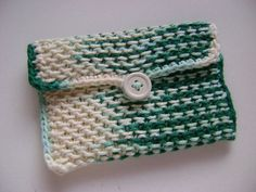 """Chinese wave pouch - a quick knit pattern with simple crochet edging!   Super simple and a great """"purse project"""" – small enough to keep in your bag for those quiet waiting room moments… and great for keeping your purse or bag organized when it's all done! The thick fabric keeps even delicate items safe and secure."""