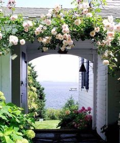 Pergola with flowers to soften garage Beautiful Gardens, Beautiful Homes, Beautiful Places, Beautiful Life, Beautiful Landscapes, Cottages By The Sea, Beach Cottages, Dream Garden, Home And Garden