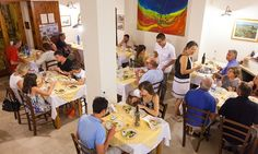 Crowded dining area at Pensione Tranchina, Scopello, Sicily