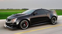 Hennessey VR 1200 Twin Turbo 2014 Cadillac CTS V.  427 CID (7.0l) Aluminum V8 1,226HP @ 6,400RPM, 1,109 lb-ft torque @ 4,000RPM, 0 - 60mph: 2.9 seconds, 1/4 mile: 10.2 @ 141mph. Top speed: 242 mph.