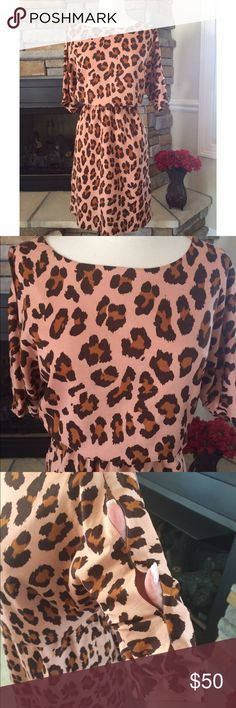W118 Walter Baker Leopard Print Dress In new condition. Gathers at waist. Tan/peachy color with darker shades of brown. Open cold shoulder look on sleeves. Beautiful dress. Fits true to size W118 by Walter Baker Dresses Midi