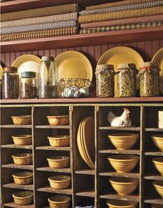 grrreat way to display collection of yellow ware!!! adding old glass jars on top and above old linens!!! awwwesome!