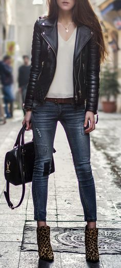 Leather jacket in combination with the white shirt... awesome!