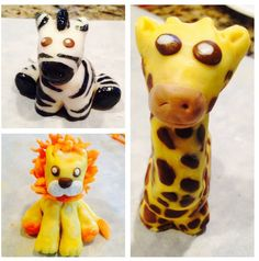 Zoo animal baby shower cake toppers made from rice crispies & covered in modeling chocolate  www.facebook.com/sidewaysconfections