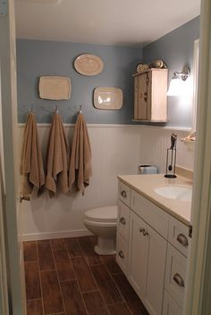 beautiful bathroom renovation idea    #bathroom #tile #faux wood floor #vanity #glass tile #wood printed tile
