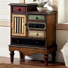 With multi-colored drawers and a 2-tier top, this eye-catching chest brings antiqued appeal to any ensemble. Add it to the entryway to stow stamps and stationary, or let it stage a flickering candle lantern in the den for a touch of boho-chic style.
