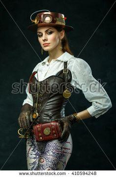 Portrait of a beautiful steampunk girl, hat with eyewear. Victorian woman in alternative history. Grunge background.