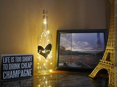 Add a golden touch to your home or office with this stunning light up bottle! Available in 10 color options.